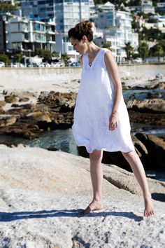 Linen Peasant dress. Made for that everlasting feel of summer and youthfulness. This is perhaps the most fitting selection if you are buying your first item of linen clothing. This is a sleeveless loose-fitting dress with inseam pockets. The silhouette is crisp and clean.  French peasant dress. Flax plant. Cape Town. Africa. Women Fashion. Natural clothing. Freedom. Linen clothing. Flax Plant, Natural Clothing, Cape Town, Clothing Items, Crisp, Going Out, Freedom, Africa, Silhouette