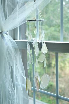 The colors of the waves with the light reflecting off them can be had hanging by your window. These wind chimes made with stained sea glass look