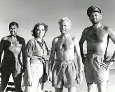 """Ice Cold In Alex"" (1958) is a desert war film, a British production based on the novel of the same name. It's 1942, the British have retreated from Tobruk. John Mills plays Anson, a British ambulance officer, suffering battle fatigue and alcoholism, who tries to get his passengers back safely to Alexandria where he dreams of downing an ice cold glass of beer. His passengers include the great character actor Harry Andrews, who nearly steals the show, two nurses, and a mysterious South…"