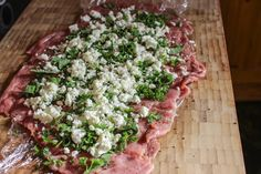 Spinach Herb Feta Stuffed Pork Loin | http://www.ninetodivine.com/divine-recipes/spinach-herb-feta-pork-loin/