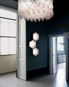 Hexagon wall lights (Dimore Studio: their apartment in Milan. 1961 Venini chandelier and vintage Silnovo hexagonal wall lights.)