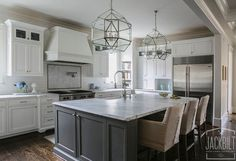 White and Gray Kitchen Designed by JackBilt Homes.