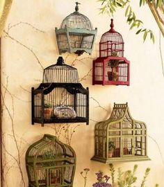 Bird houses on a wall, awesome idea for a deck.