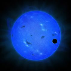 An artist's rendition of Gliese 1214 b traveling in front of its star, shown in blue light.