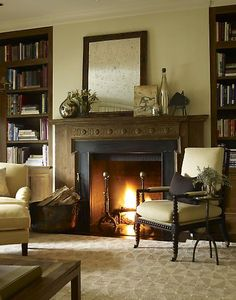 Built-in book shelves bordering fireplace.  See accompanying photo showing front windows to left of book shelves.