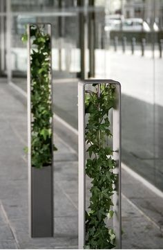 green creeper bollards ~via mimilin.tumblr.com catastrophe-urben:  conceptlandscape:  HEDERA Bollard  Brilliant