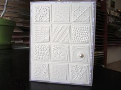 handmade card ... white inchies cut punched from different embossing folder textured paper ... luv the careful selection of the design ... multi-layered for extra texture ... luv it!