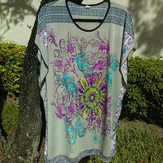"Caftan styled blouse - Looks NWOT Beautifully patterned both sides - beige, pink, aqua - no tags - fits like 1X (16W) - shoulder to hem 30"" Tops Blouses"