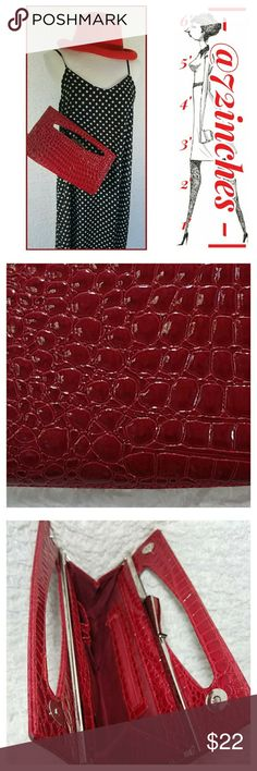 Red Alligator Embossed Clutch Get noticed when carrying this stunning clutch. It's the perfect addition to any woman's party going accessories. Inside zippered pocket and three smaller pockets on a ridgid metal frame construction. Secure closure is both a magnetic catch and 2 snaps Bags Clutches & Wristlets