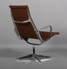 Charles Eames, 1907 1978. Lounge Chair From The Aluminium Group Series,  Model EA 116. Brown Hopsack. Chromed Aluminium Base And Armrests, Swivel  Function.