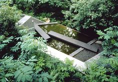 Stone? Concrete? creates a bridge across a water feature (Michael Van Valkenburgh Associates, Inc.)