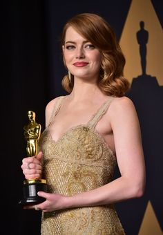 Emma Stone Photos Photos - Emma Stone poses in the press room with the Oscar for Best Actress during the 89th Annual Academy Awards on February 26, 2017, in Hollywood, California. / AFP / FREDERIC J. BROWN - 89th Annual Academy Awards - Press Room
