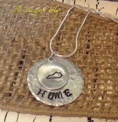 A personal favorite from my Etsy shop https://www.etsy.com/listing/251967907/kentucky-home-hand-stamped-metal