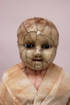 This doll, made around 1850, is the only known remaining example of the work of London wax and composition doll maker, Anthony Bazzoni.  Handblown glass eyes by another artisan. Shelburn Museum collection.