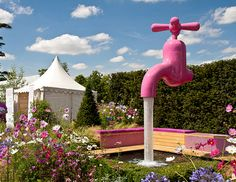 A temporary magic tap was installed at the Hampton Court Palace Flower Show, London, UK.