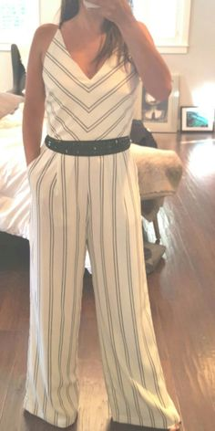 Love this stripe jumpsuit  available online at maidelin.com