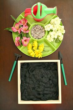 Flower Garden Play Dough Invitation - could also have green play dough for grass instead of dirt-ideas for indoor play with loose part materials.