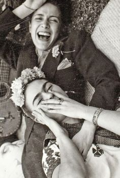 Not often do you see photos of Frida Kahlo laughing...