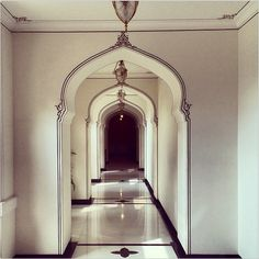 These are the halls of the Rambagh Palace a hotel in India.
