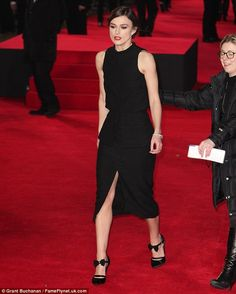 The thigh's the limit: The actress added a hint of glamour with a brave thigh-split, which revealed a hint of her toned alabaster legs as sh...