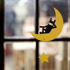 This adorable paper mobile by JStory features the ninja bunny relaxing on a crescent moon. This paper mobile requires a bit of DIY, but the package will come wi Paper Mobile, Bat Signal, Superhero Logos, Bunny, Clock, Moon, Symbols, Cards, Mobiles