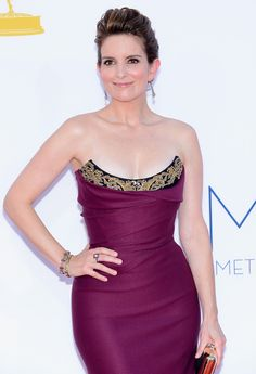 Emmys WERQ: Tina Fey in Vivienne Westwood | Tom & Lorenzo    This is the best I have ever seen Tina Fey look on the red carpet. She looks gorgeous and her waist looks tiny.  Plus I love the intricate detail at the top of the dress. No more black! good job Tina :)