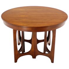Mid-Century Modern Walnut Round Dining Table | From a unique collection of antique and modern dining room tables at https://www.1stdibs.com/furniture/tables/dining-room-tables/