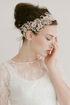 A headband of rhinestone and pearls is the crowning detail on your wedding day.