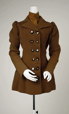 Double-breasted brown wool jacket, by B. Altman & Co. American, ca. 1891. Part of a matching ensemble, with brown wool bodice with pointed lapels, and brown velvet and wool cap.