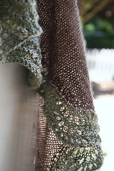 soft, drapey from Coastal Knits. click thru and  it will take you to Ravelry.com from their site.  It is a really beautiful shawl but I feel that it could be about 4xtimes larger.