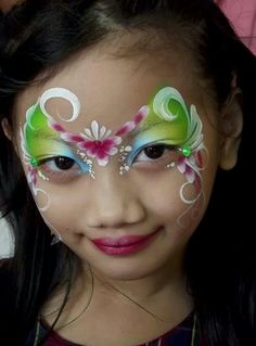 Fast and loose: Assymmetrical Butterfly face paint design