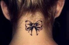 small bow tattoo: