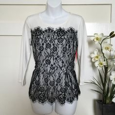 •Lace Peplum Top• This lovely lace overlay has a romantic look style• Pleated peplum hem• Crewneck with 3/4 length sleeves• Body: 57% Cotton, 38% Modal, 5% Spandex• Lace: 100% Nylon• Size runs big fits a medium• No Trade/PP Elle Tops Tunics