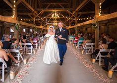 Stunning image of a ceremony in the barn Warrenwood Manor located in Danville, KY, photo by Kevin and Anna Photography!