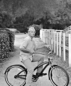 Bill Murray on a bicycle.