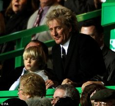 Now let me explain the offside rule: Rod Stewart and his son Alistair watch the