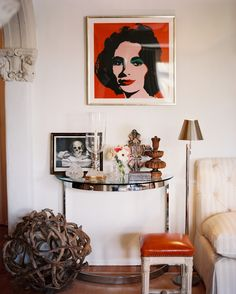 Bohemian Eclectic Traditional Living Room: A Warhol piece hung above a chrome-and-glass end table.