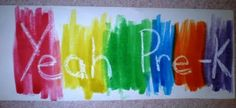 Trace name with white crayon, then paint with rainbow watercolors.