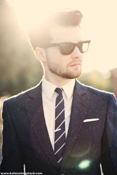 Men Fashion - Subtle tweaks to your typical suit and tie look make all the difference - the jacket detail, slim striped tie, tie bar, pocket square and Ray Bans make this suit look fun and fresh!