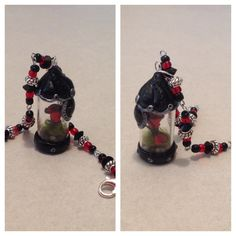 Polymer clay single singed rose with one dropped petal in a gothic glass vial..a bracelet I made for a friend