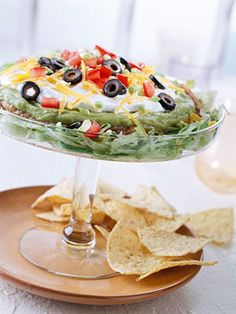 Mexican 7-layer Salad: This perennial party favorite recipe boasts luscious guacamole, a layer of hearty beans, and cheese.