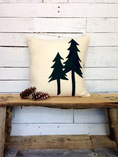 ~This is a wool fabric pillow. The color is linen, ivory. ~The trees are dark green wool and a dark green/blue plaid wool fabric. ~The trees are hand