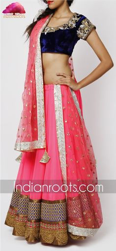 Neon pink georgette lehenga with blue velvet blouse by Kylee on Indianroots.com