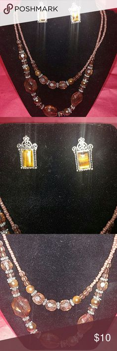 """Necklace and earrings set ( pierced earrings ) This is a beautiful set. It includes tigers eye swirl earrings and a double chain necklace set. The necklace measurements are 10"""" long from clip to bead ( see photos ). Thank you for visiting my closet . Happy Poshing ! Jewelry Necklaces"""