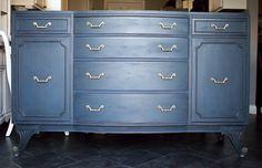 Buffet refinished with Annie Sloan Napoleonic Blue as and under layer and a mix of Graphite and Napoleonic Blue as a top layer. The piece was lightly distressed and sealed with clear and dark wax. Check out all my work on Perfectly Imperfect Pieces on Facebook.