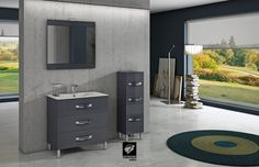 Mueble de baño modelo GARONA de TORVISCO GROUP. Mueble de 80cms con tres cajones en acabado GRAFITO BRILLO. Acompañado de columna de 35cms y espejo CORFÚ . Encimera extrafina y foco IZARO. De nuestro catálogo BATHONE.