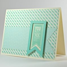 handmade card ... monochromatic aquas ... fishtails and patterned papers ... like the framed look of the focal point fishtail ...