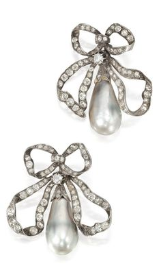A Pair of Antique Natural Pearl and Diamond Brooches, 19th Century. Designed as bows, suspending two slightly baroque natural pearls measuring approximately 13.2 mm and 14.0 x 13.8 mm, the surmounts set with old European-cut diamonds, accompanied by brooch fittings and hair pins for variety of wear.