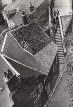 André Kertész Touraine, France From the time he arrived in Paris, Kertész was fascinated by the Paris rooftops and by views of the city. Up until his death, he made repeated use of the high-angle perspective for its capacity to render space. Minimalist Photography, Urban Photography, Color Photography, Street Photography, Vintage Photography, Creative Photography, Andre Kertesz, Budapest, Piet Mondrian