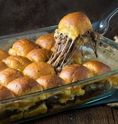 Baked Mississippi Roast Party Sandwiches on Martin's Party Potato Rolls!  This ooey gooey recipe is sure to wow your friends and family this holiday season...and it's so easy to prepare!  (Your crock-pot does most of the work!).